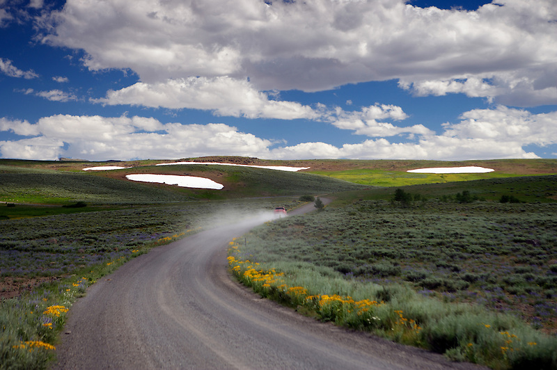 Dirt road with car. Steens Mountain. Oregon