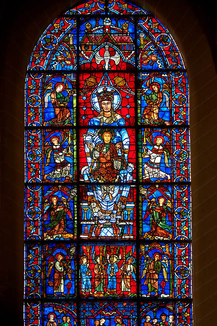 Medieval Windows  of the Gothic Cathedral of Chartres, France, dedicated to Notre Dame de la Belle Verriere. The centre panels show the Virgin Mary and child below which are Four angels bearing columns supporting the 'Throne of Wisdom' with panels showing angels around the Virgin and Child. A UNESCO World Heritage Site.