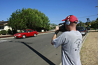 """Sunday August,10 2008 San Diego, CA.  Members of the production company Renegade Swine Joe Park, (with camera) Dave Yim (driving) and Adrienne Ziegler work on the movie """"The Paper Spy"""" in Pacific Beach.  The Renegade Swine team was part of the 48-Hour Film Project, a contest to write, shoot, edit and score an entire movie in just two days."""