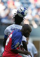 Walter Martinez (15) heads the ball over Markdrel Sampuer (16). Honduras defeated Haiti 1-0 during the First Round of the 2009 CONCACAF Gold Cup at Qwest Field in Seattle, Washington on July 4, 2009.