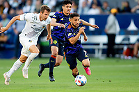 CARSON, CA - JUNE 19: Cristian Roldan #7 of the Seattle Sounders FC moves with the ball towards the box during a game between Seattle Sounders FC and Los Angeles Galaxy at Dignity Health Sports Park on June 19, 2021 in Carson, California.