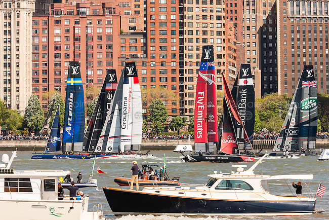 Louis Vuitton America's Cup World Series team catamarans race on the Hudson River course surrounded by spectator boats.