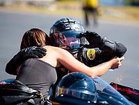 Oct 14, 2019; Concord, NC, USA; NHRA pro stock motorcycle rider Jianna Salinas (left) greets Karen Stoffer during the Carolina Nationals at zMax Dragway. Mandatory Credit: Mark J. Rebilas-USA TODAY Sports