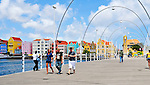 2 August 2009: Tourists cross the Queen Emma floating bridge in Willemstad, the capital city of Curacao. Located in the southern Caribbean, off the coast of Venezuela, Curacao is known for its tourism, excellent scuba diving and snorkeling.  Mandatory Credit: Ed Wolfstein Photo