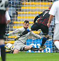 Raith Rovers' keeper Kevin Cuthbert saves at point blank range from Caley's Billy McKay.