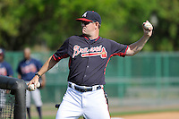 Pitching coach Dan Meyer of the Atlanta Braves farm system throws batting practice before a Minor League Spring Training intrasquad game on Wednesday, March 18, 2015, at the ESPN Wide World of Sports Complex in Lake Buena Vista, Florida. (Tom Priddy/Four Seam Images)