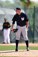 Pitcher Tyler Webb (66) of the New York Yankees organization during a minor league spring training game against the Pittsburgh Pirates on March 22, 2014 at Pirate City in Bradenton, Florida.  (Mike Janes/Four Seam Images)
