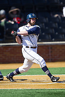 Steve Anderson (19) of the Georgetown Hoyas follows through on his swing against the Marshall Thundering Herd at Wake Forest Baseball Park on February 15, 2014 in Winston-Salem, North Carolina.  The Thundering Herd defeated the Hoyas 5-1.  (Brian Westerholt/Four Seam Images)