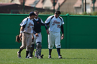18 April 2010: Tim Stewart of Savigny is seen with Yan Dal Zotto and Vincent Ferreira as he hurts himself on a catch against the green wall on left field during game 1/week 2 of the French Elite season won 8-1 by Savigny (Lions) over Senart (Templiers), at Parc municipal des sports Jean Moulin in Savigny-sur-Orge, France.