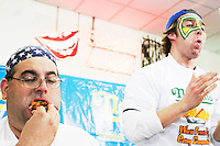 """Ed """"Cookie"""" Jarvis, left, and Tim """"Eater X"""" Janus at the I.F.O.C.E. sanctioned World French Fry Eating Championship, in New York City on March 31, 2005."""