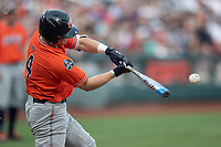Auburn Tigers first baseman Rankin Woley (4) swings the bat during Game 4 of the NCAA College World Series against the Mississippi State Bulldogs on June 16, 2019 at TD Ameritrade Park in Omaha, Nebraska. Mississippi State defeated Auburn 5-4. (Andrew Woolley/Four Seam Images)