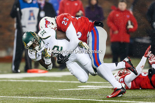 Southern Methodist Mustangs and South Florida Bulls players and fans in action at the Gerald J. Ford Stadium in Dallas, Texas.