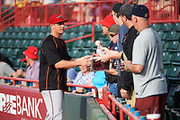 Richmond Flying Squirrels pitcher Kyle Crick (49) signs autographs before a game against the Erie SeaWolves on May 27, 2016 at Jerry Uht Park in Erie, Pennsylvania.  Richmond defeated Erie 7-6.  (Mike Janes/Four Seam Images)