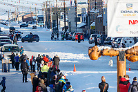 Aaron Burmeister runs down Front street and up into the finish chute in Nome on Wednesday March 14th as he completes the 2018 Iditarod Sled Dog Race.  <br /> <br /> Photo by Jeff Schultz/SchultzPhoto.com  (C) 2018  ALL RIGHTS RESERVED
