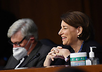 United States Senator Amy Klobuchar (Democrat of Minnesota), speaks during a US Senate Judiciary Committee confirmation hearing on the nomination of Amy Coney Barrett for Associate Justice of the Supreme Court, on Capitol Hill in Washington, DC on Thursday, October 15, 2020.  If confirmed, Barrett will replace Justice Ruth Bader Ginsburg, who died last month.  <br /> Credit: Kevin Dietsch / Pool via CNP /MediaPunch