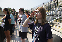 Eshe Shearer salutes during a playing of the National Anthem, Thursday, September 9, 2021 at Tiger Stadium in Bentonville. The district is educating students on the 9/11 attacks. Students completed 40 climbs up the home bleachers, the equivalent of the 110 stories (2200 stairs) of the Twin Towers. Check out nwaonline.com/210910Daily/ for today's photo gallery. <br /> (NWA Democrat-Gazette/Charlie Kaijo)