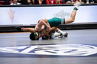 STANFORD, CA - March 7, 2020: Benny Martinez of Cal Poly and Jayden Carson of Little Rock during the 2020 Pac-12 Wrestling Championships at Maples Pavilion.