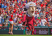 14 April 2013: Washington Nationals mascot Thomas Jefferson wins the Presidents race between innings of a game between the Atlanta Braves and the Washington Nationals at Nationals Park in Washington, DC. The Braves shut out the Nationals 9-0 to sweep their 3-game series. Mandatory Credit: Ed Wolfstein Photo *** RAW (NEF) Image File Available ***