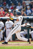 Michigan Wolverines catcher Joe Donovan (0) swings the bat during Game 1 of the NCAA College World Series against the Texas Tech Red Raiders on June 15, 2019 at TD Ameritrade Park in Omaha, Nebraska. Michigan defeated Texas Tech 5-3. (Andrew Woolley/Four Seam Images)