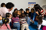 Education preschool 3-4 year olds horizontal circle time group of children and two female teachers