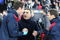 Swansea manager Carlos Carvalhal (C) congratulated by Jez McCluskey (L) and Ritson Lloyd during the Premier League soccer match between Swansea City and Arsenal at the Liberty Stadium, Swansea, Wales, UK. Tuesday 30 January 2018