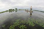 A makoro canoe is the transportation of choice in the Okavango Delta
