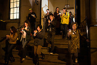 People walk from the Arlington Street Church to the Public Garden at Boston Common in Boston, Mass., for a candlelight vigil on April 16, 2013, the day after bombings at the Boston Marathon.