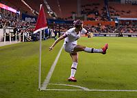 Megan Rapinoe #15 of the United States takes a corner kick