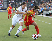 Ali Krieger #16 of the USA WNT goes for the ball against Yasha Gu #24 of the PRC WNT during an international friendly match at KSU Soccer Stadium, on October 2 2010 in Kennesaw, Georgia. USA won 2-1.