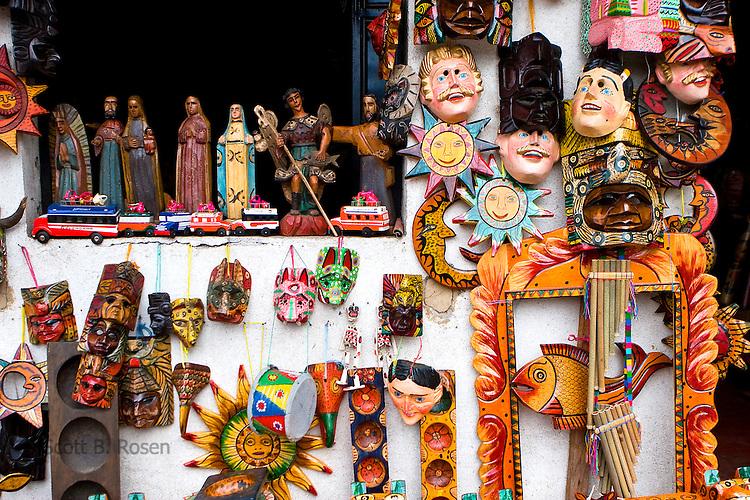 Close-up of traditional Guatemalan masks and handicrafts at market in San Pedro La Laguna, Lake Atitlan, Guatemala