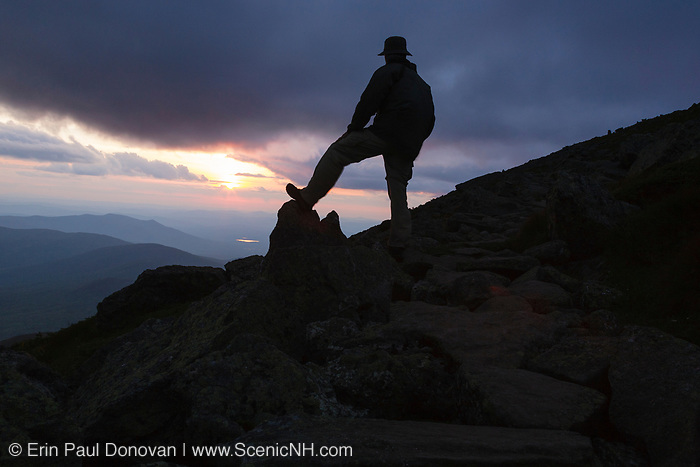Silhouette of rock cairn and hiker along the Appalachian Trail near Mount Clay in the White Mountains, New Hampshire USA during the summer months.