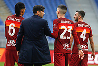 Roma's coach Paulo Fonseca, second from left, congratulates with his players Chris Smalling, left, Gianluca Mancini, second from right, and Roma's Bryan Cristante during the Italian Serie A Football match between Roma and Genoa at Rome's Olympic stadium, March 7, 2021.<br /> UPDATE IMAGES PRESS/Riccardo De Luca