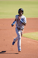 Surprise Saguaros right fielder Nick Heath (21), of the Kansas City Royals organization, runs to third base during an Arizona Fall League game against the Scottsdale Scorpions at Scottsdale Stadium on October 26, 2018 in Scottsdale, Arizona. Surprise defeated Scottsdale 3-1. (Zachary Lucy/Four Seam Images)