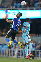 SAN JOSE, CA - AUGUST 17: Jeremy Ebobisse #11 of the San Jose Earthquakes goes up for a header with Romain Metanire #19 of Minnesota United during a game between Minnesota United FC and San Jose Earthquakes at PayPal Park on August 17, 2021 in San Jose, California.