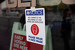 "BROOKLYN, NY — OCTOBER 24, 2020:  A sign reading ""please wear a face mask' is displayed in front of the Barclay's Center, during the first day of early voting in the U.S. Presidential Election, on October 24, 2020 in Brooklyn, NY.  Photograph by Michael Nagle"