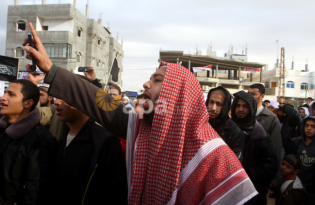 A Palestinian Salafist takes part in a protest against Syria's President Bashar al-Assad in Rafah in the southern Gaza Strip February 24, 2012. Photo by Ashraf Amra