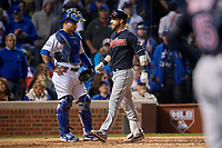 Cleveland Indians Jason Kipnis (22) touches home plate after hitting a home run as Wilson Contreras (40) looks on in the seventh inning during Game 4 of the Major League Baseball World Series against the Chicago Cubs on October 29, 2016 at Wrigley Field in Chicago, Illinois.  (Mike Janes/Four Seam Images)