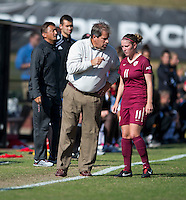 Florida State head coach Mark Krikorian talks to his Isabella Schmid (11) during the game at Ludwing Field in College Park, MD.  Florida State defeated Maryland, 1-0.