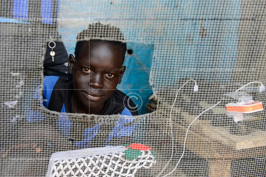 ETHIOPIA, Gambela, Itang, village Braziel, mobile phone battery recharge shop/ AETHIOPIEN, Gambela, Region Itang, Dorf Braziel, kleiner Laden zur Handy Batterie Aufladung
