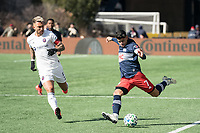 FOXBOROUGH, MA - MARCH 7: Gustavo Bou #7 of New England Revolution crosses the ball as Francisco Calvo #5 of Chicago Fire comes to block during a game between Chicago Fire and New England Revolution at Gillette Stadium on March 7, 2020 in Foxborough, Massachusetts.