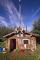 Rustic log cabin along the Yukon River, Canada