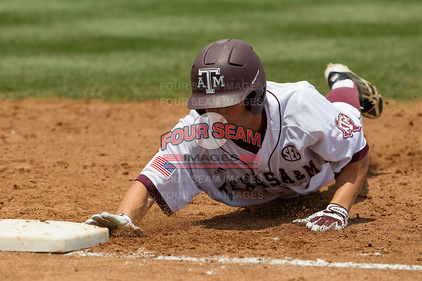 Texas A&M Aggies designated hitter Daniel Mengden (15) dives back to first base during a pick off attempt against the LSU Tigers in the NCAA Southeastern Conference baseball game on May 11, 2013 at Blue Bell Park in College Station, Texas. LSU defeated Texas A&M 2-1 in extra innings to capture the SEC West Championship. (Andrew Woolley/Four Seam Images).