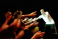 Montreal, April, 21, 2000<br /> Rap performer `` Eminem `` reach out to his fans during a recent concert.