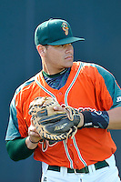 Catcher Roy Morales (17) of the Greensboro Grasshoppers warms up before a game against the Greenville Drive on Thursday, July 14, 2016, at Fluor Field at the West End in Greenville, South Carolina. (Tom Priddy/Four Seam Images)