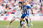 Isco Alarcon (l) of Real Madrid battles for the ball with Victor Camarasa Ferrando of Deportivo Alaves during their La Liga match between Real Madrid and Deportivo Alaves at the Santiago Bernabeu Stadium on 02 April 2017 in Madrid, Spain. Photo by Diego Gonzalez Souto / Power Sport Images