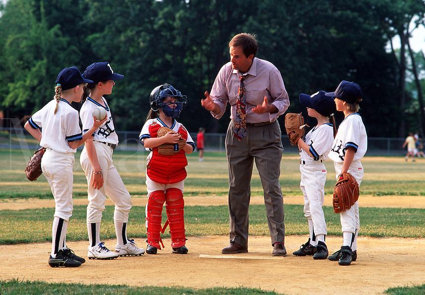 Coach and girls' softball team.