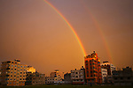 a pictuer taken on february 15, 2017 shows a rainbow appering over gaza city. Photo by Osama Baba