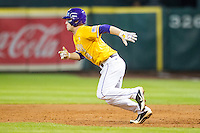 LSU Tigers shortstop Alex Bregman (8) runs to second base during the Houston College Classic against the Nebraska Cornhuskers on March 8, 2015 at Minute Maid Park in Houston, Texas. LSU defeated Nebraska 4-2. (Andrew Woolley/Four Seam Images)