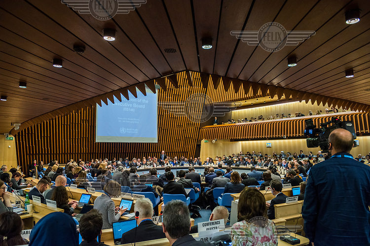 Attendees in the hall at the opening session of the Executive Board Meeting of the World Health Organisation, the UN's health body, at the organisation's headquarters in Geneva. The annual event is taking place in the shadow of the Corona virus outbreak, which the WHO has declared as global health emergency.