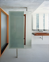 This modern bathroom is distinguished by an unusual wooden wash basin